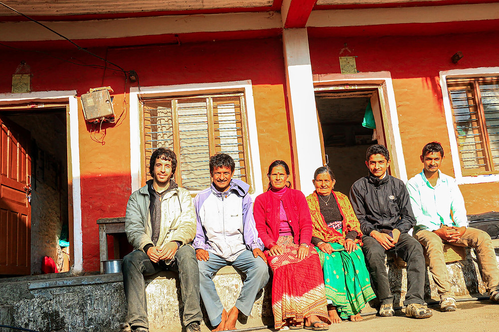 Miguel Cano with a Nepali family at the Pokhara Lakes