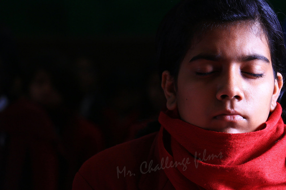Nepali girl meditating with her eyes closed