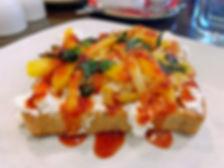 Sliced mango, goat cheese, tahini, fresh mint, spicy honey.