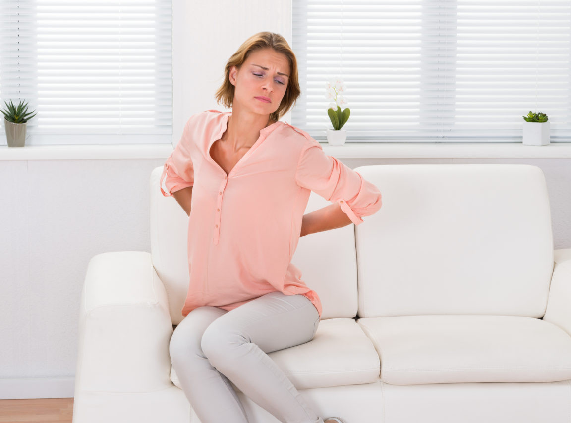 woman-sofa-low-back-pain-iStock-50387582