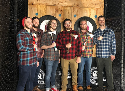 guys with axes posing in front of targets.jpg