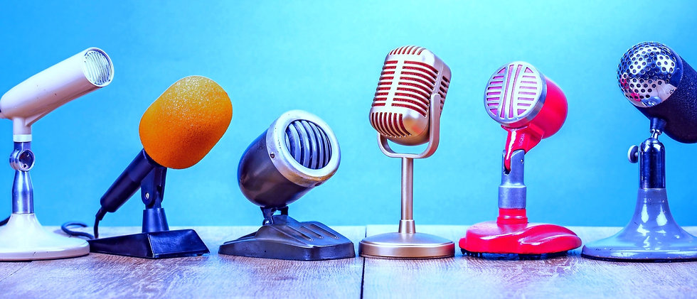 Retro old microphones for press conference or interview on table front gradient aquamarine backgroun
