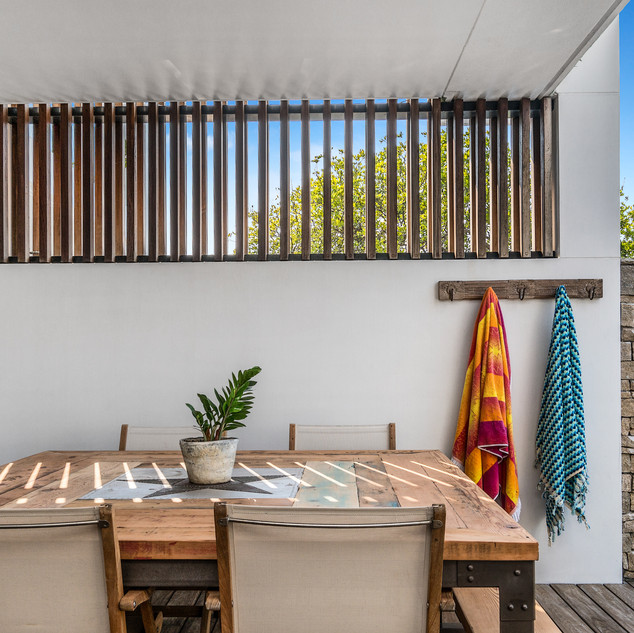 Covered outdoor deck and dining area