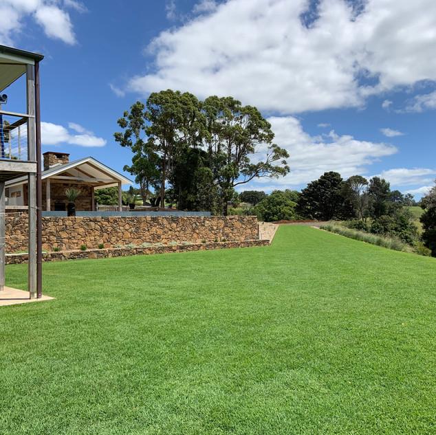 Private, grassy exterior