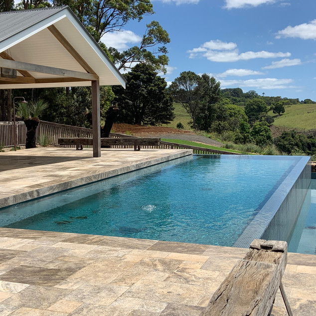 Undercover entertaining overlooking sparkling pool