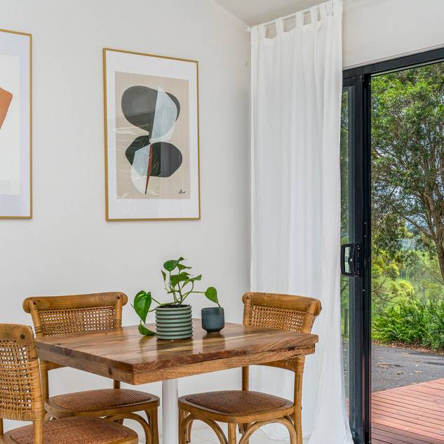 Dining room extends to sun drenched deck