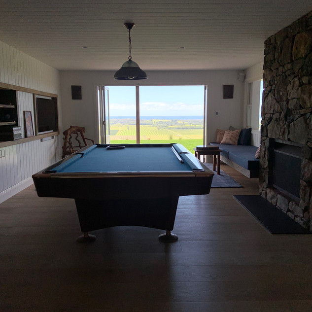 Games room with fireplace and reading nook