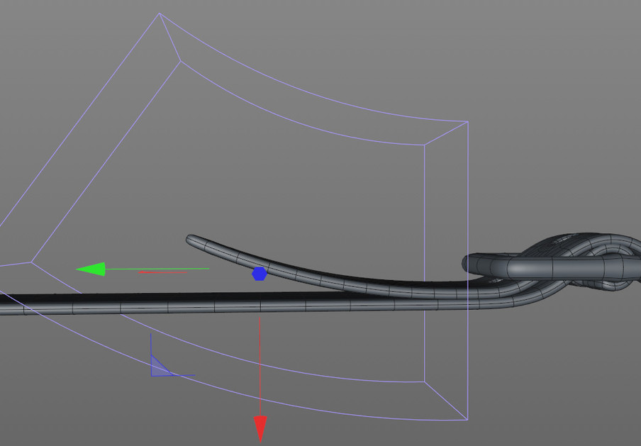 Once positioned the strap was extruded then modified using a Bend Deformer.
