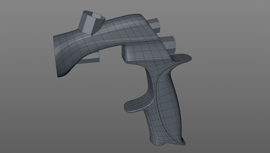 The topology was adjusted to add an indent on the handle and slight insets into the side of the gun.
