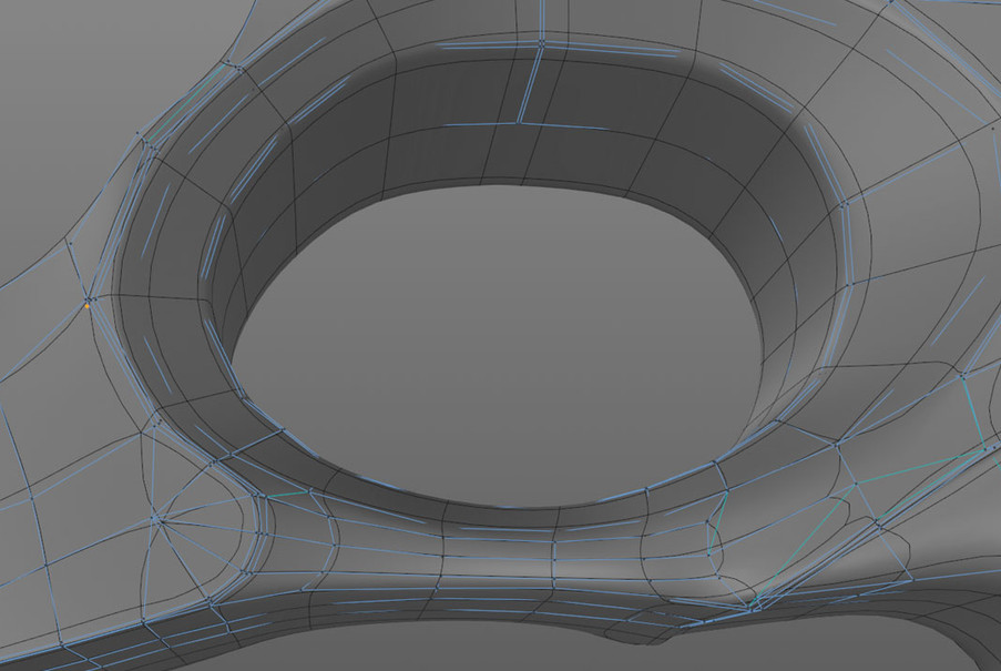 Sharpening the trigger section required extra loop cuts which took a little time to resolve but resulted in a pretty clean mesh.