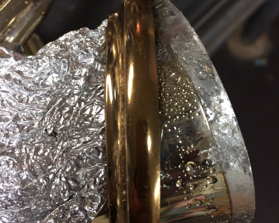 Removing damaged ring on french horn.