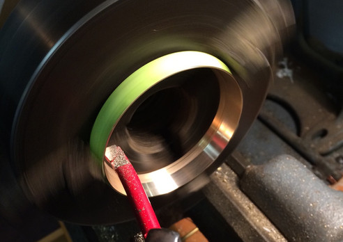 Turning a ring set to proper size for a ring set replacement to due damaged threads.