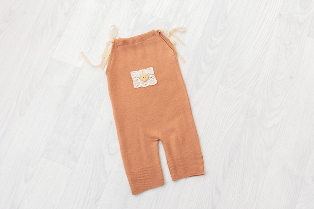 peach sitter romper for baby photoshoot