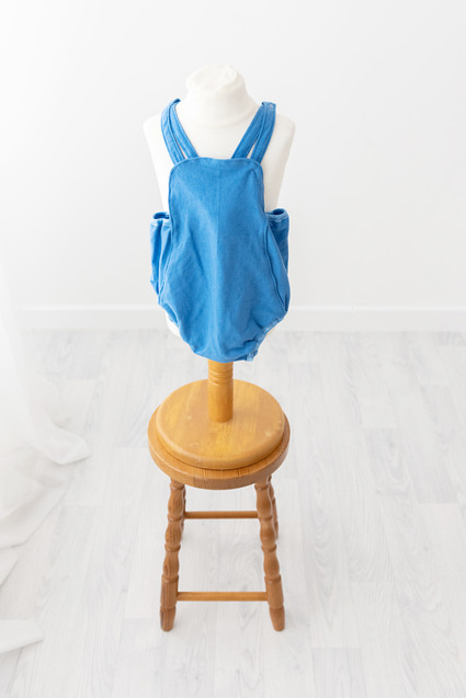blue romper for cake smash photoshoot barnoldswick