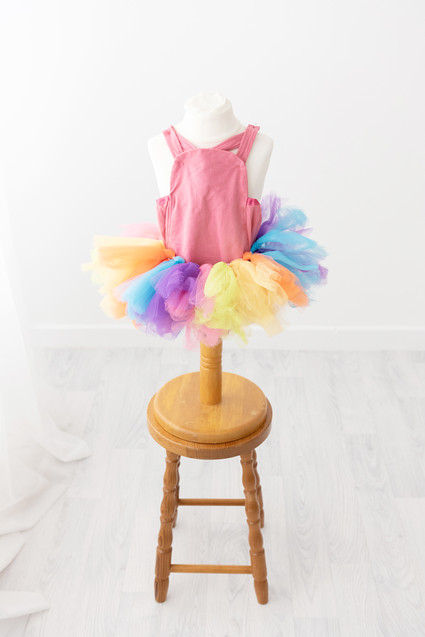 pink romper and rainbow tutu for cake smash photos barnoldswick lancashire