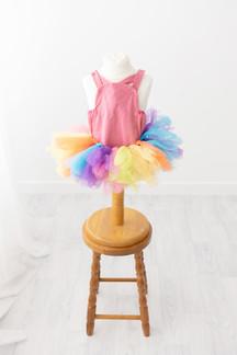 pink romper and rainbow tutu for cake smash photos barnoldswick lancashire
