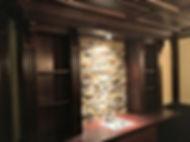 Custom built home bar with paneled ceiling