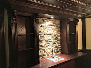 Custom built home bar with paneled ceiling