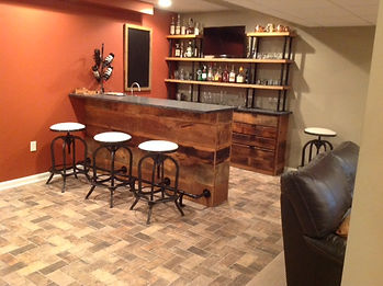 Custom bar with reclaimed wood and black iron pipe