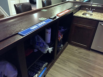 Home bar with wood top and drink shelf