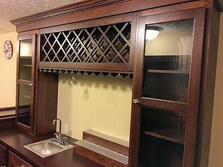 Wine bottle storage with stemware holders