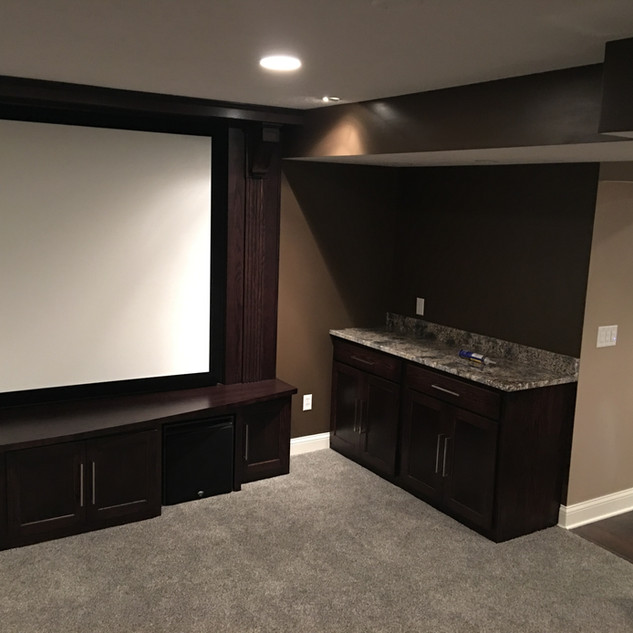 Custom built home entertainment center and walk up bar