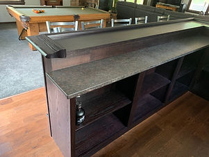 Two level home bar with dark finish