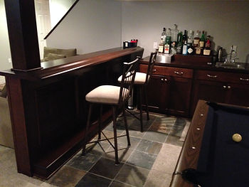 Walk-up serving style bar with a bar height sit behind counter