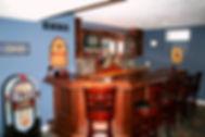 Cherry home bar with tile backsplash