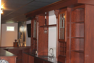 Cherry residential bar with antique leaded glass