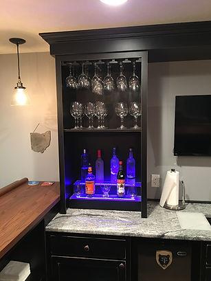 Home bar liquor display with stemware holders
