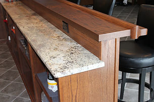 Two level home bar with wood and granite