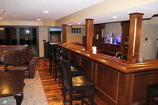 Home pub built around poles
