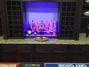 Liquor display shelf with LED lights for home pub