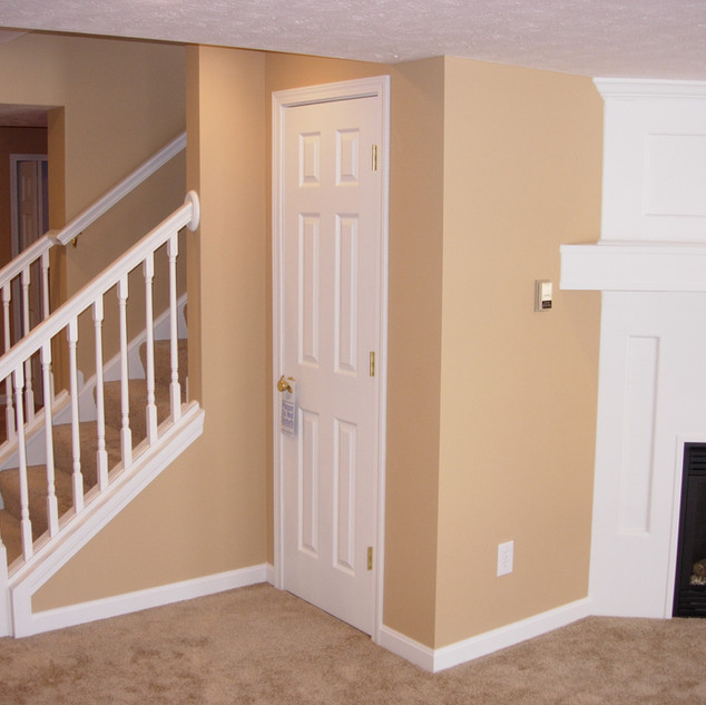 Open staircase with railing