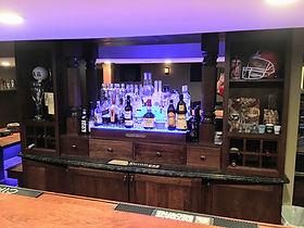 Home back bar with liquor bottle display