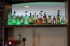 Floating liquor display shelf with LED lights
