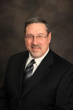 Mr. Roger Brough