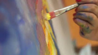 hand and paintbrush.jpeg