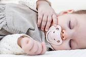 bigstock-Cute-baby-girl-sleeping-over-w-70686319.jpg