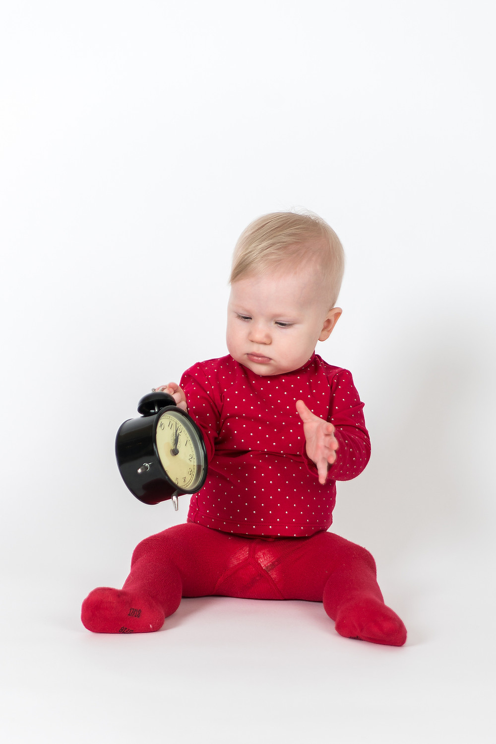 bigstock-Sitting-Baby-With-Clock-In-Red-43647406.jpg