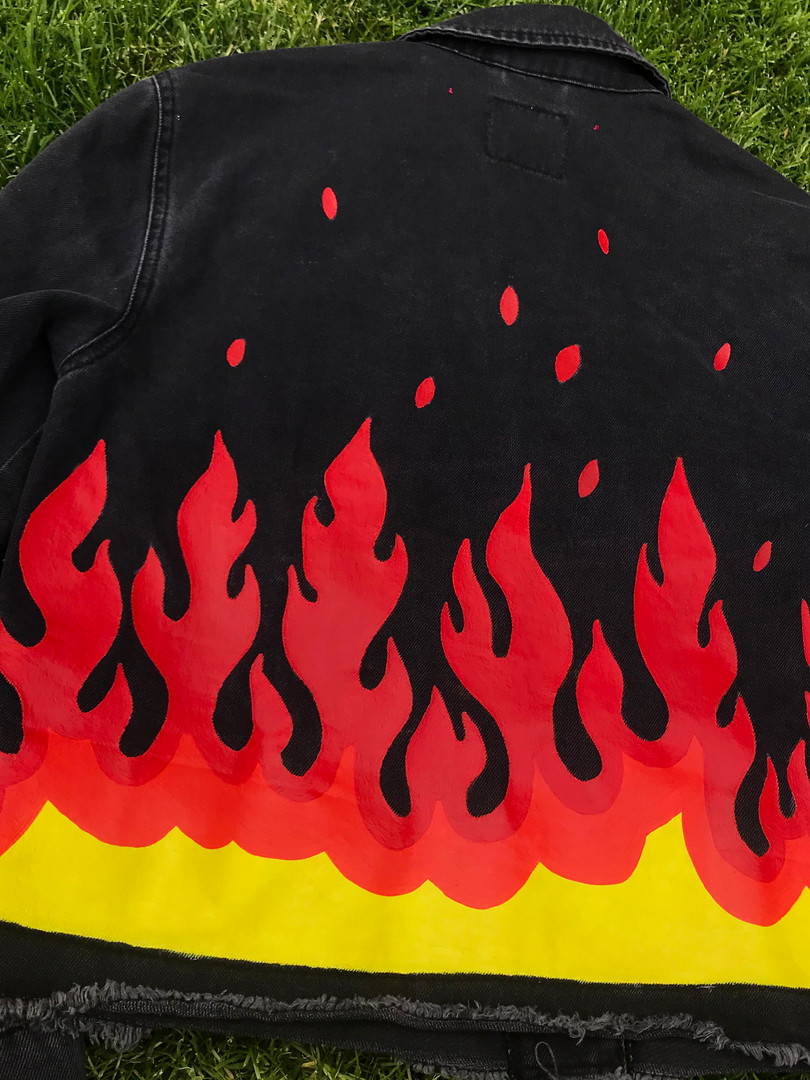 Black denim jacket, custom painted with Red Flames. Hand-painted with acrylic paint and fabric medium.