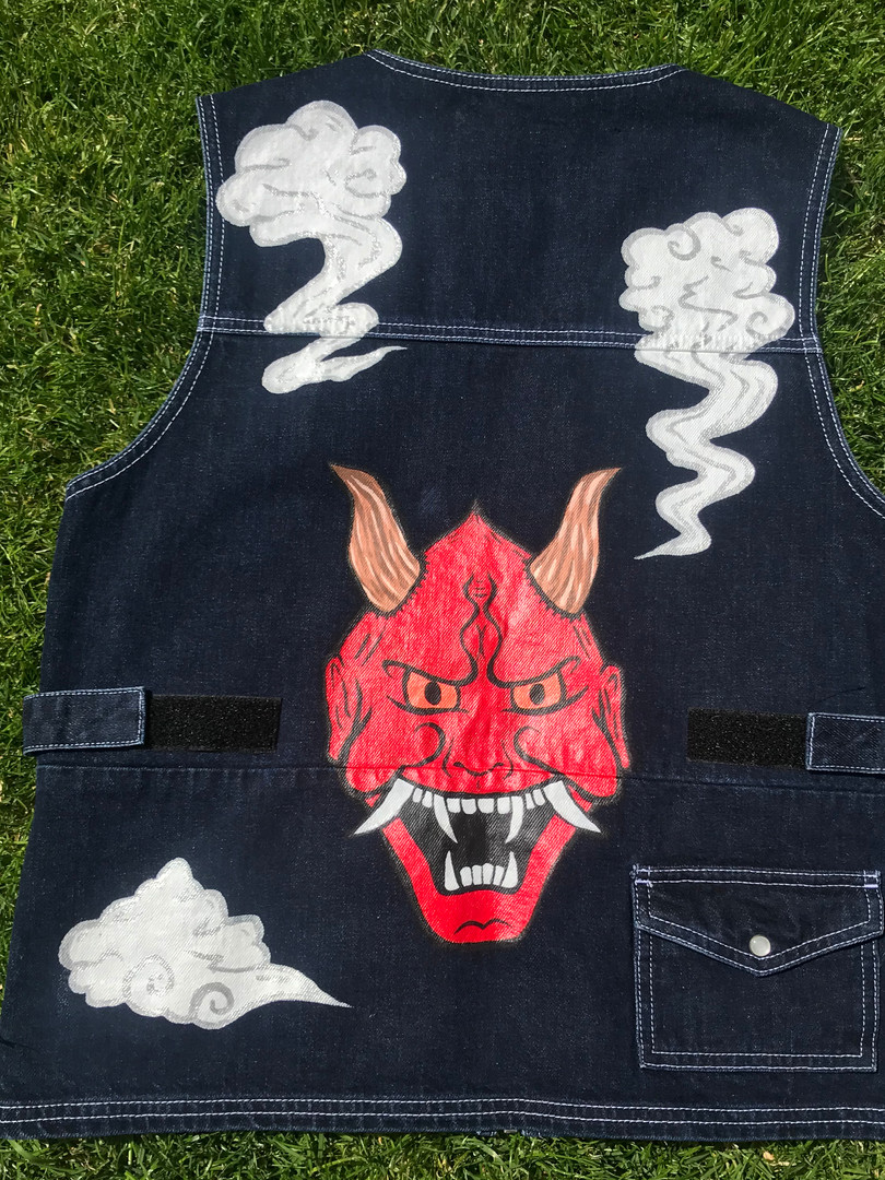 Denim streetwear Utility waistcoat. Hannya Mask design hand-painted with acrylic paint and fabric medium. Silver clouds painted with metallic silver enamel paint.