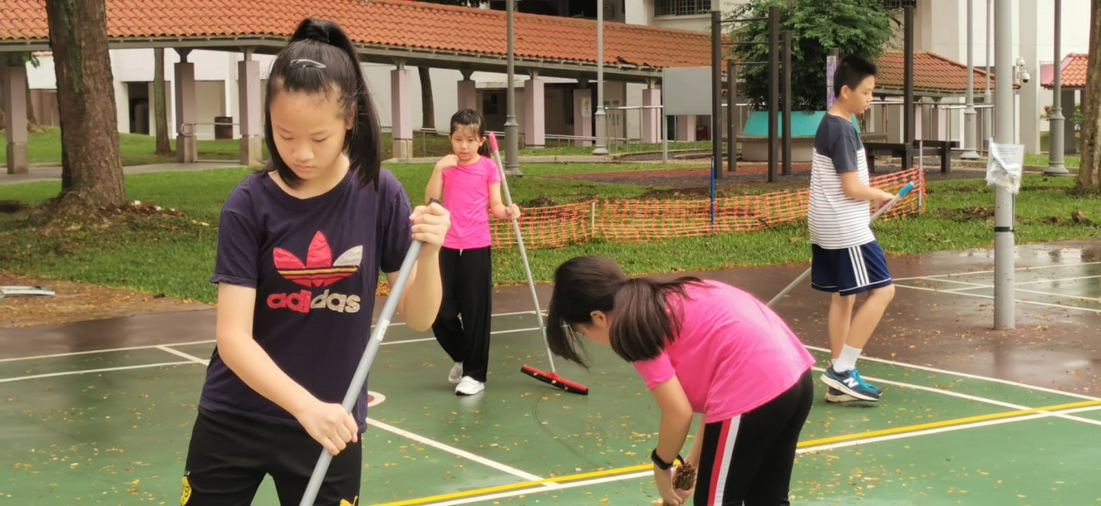 """Having trouble to get your kids to do housework?  Come join pickleball kids"" – Jeffery Kuok in Whatsapp Groupchat.  Sweeping up the courts before the lessons or play is standard practice, done without request."