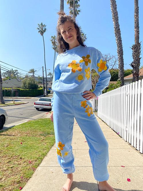 blue sweat suit w/yellow flowers