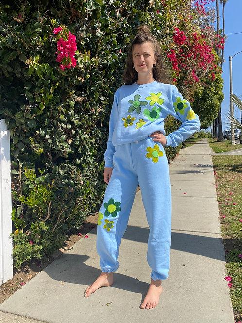 blue sweat suit w/green flowers