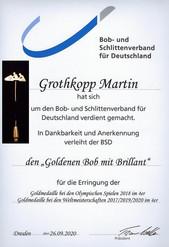 Auszeichnung Goldener Bob mit Brilliant für herausragende Leistungen im Bobsport.