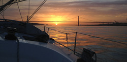 sunset at lisbon by boat