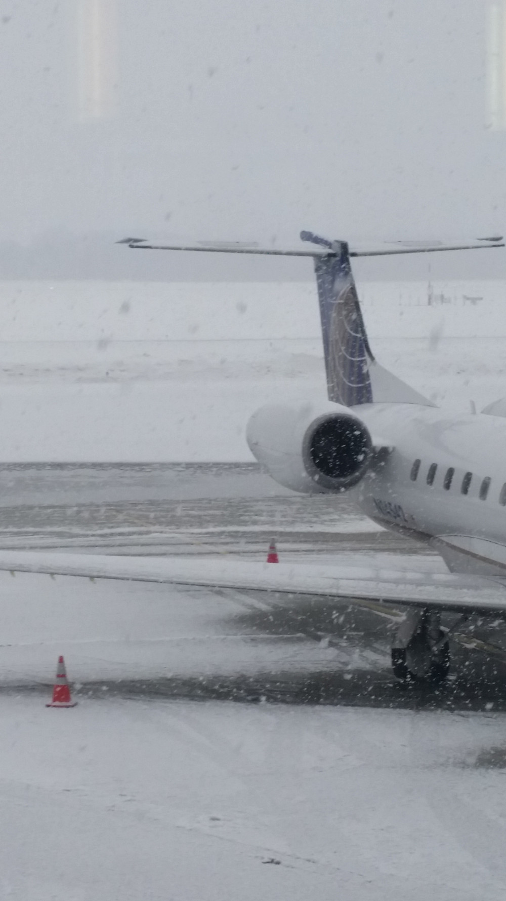 Snowy scene at the airport. Will I get out?
