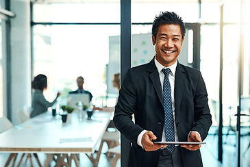 man-office-holding-tablet.jpg